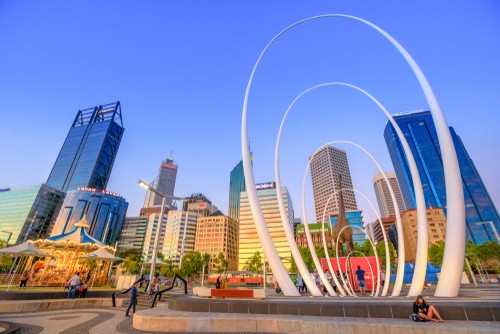 City with carousel, large office buildings and sculpture