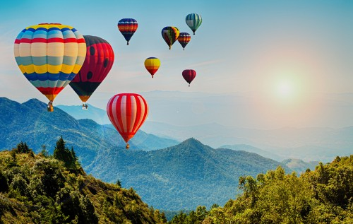 Hot air balloons flying into the distance
